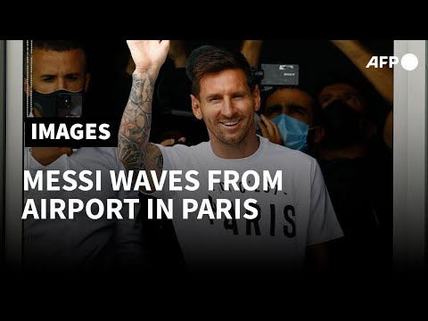 Football: Lionel Messi waves from airport window upon arrival in Paris   AFP