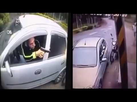attempted hijacking/robbery. robber shot other escapes. 18+ graphic footage
