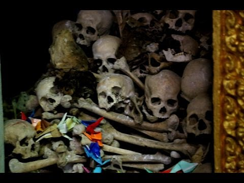Human bones and skulls of butchered victims by the Khmer Rouge in the Killing caves of Phnom Sampeau