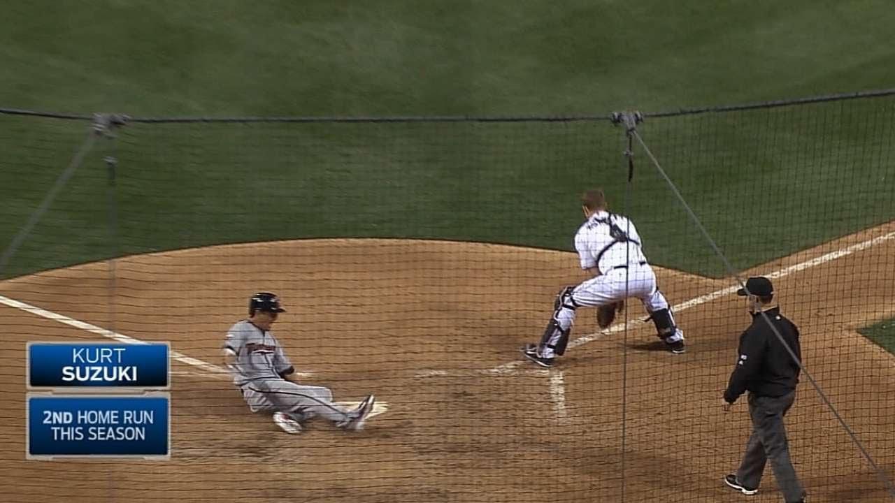 Kurt Suzuki races around the bases for an inside-the-park home run