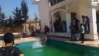 Militia pool party at U.S. embassy in Libya