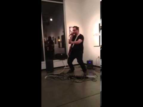 Aaron Grant performing with looper pedal- Beatbox & Guitar
