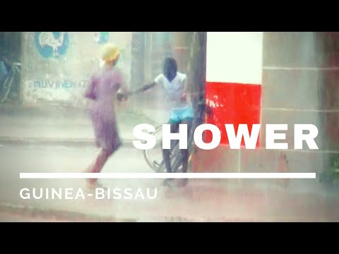 Happy street shower - Guinea Bissau