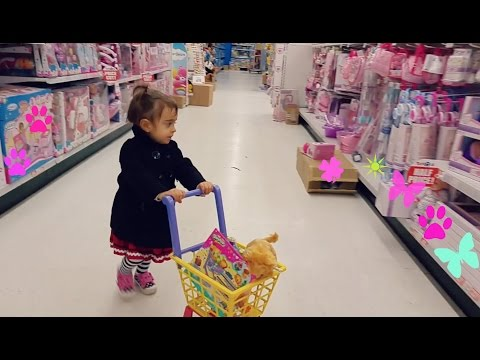 "Cute Little Girl  Doing Shopping -TOYS ""R"" US - Toy Shopping Cart thumbnail"