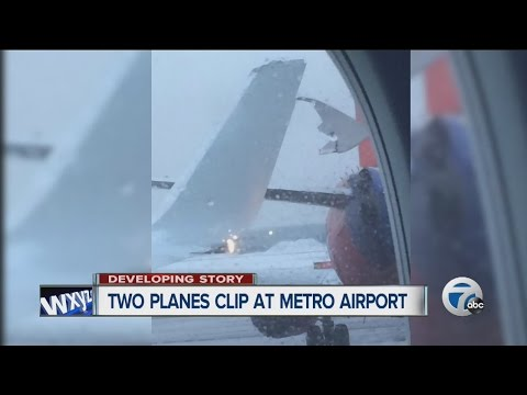 American Airlines aircraft clips another plane on taxiway at Detroit Metro Airport