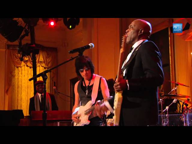 Tom performing with Jeff Beck & Buddy Guy