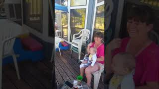Cuteness overload Big Brother making baby brother laugh by acting goofy