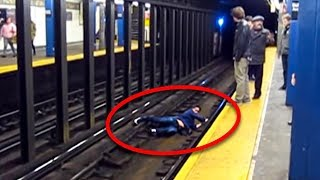 seconds-before-train-comes-this-guy-gets-trapped-onto-the-tracks-so-strangers-risk-their-life