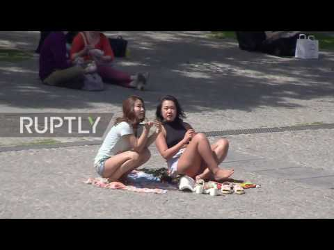 France: Parisians sunbathe by the Seine as temperatures reach 28°C
