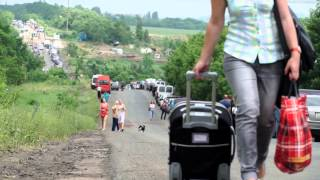 'Трудный путь из ДНР и обратно' / The traffic situation between the warring sides in Ukraine ©AFP