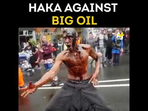 protester covered in oil does haka