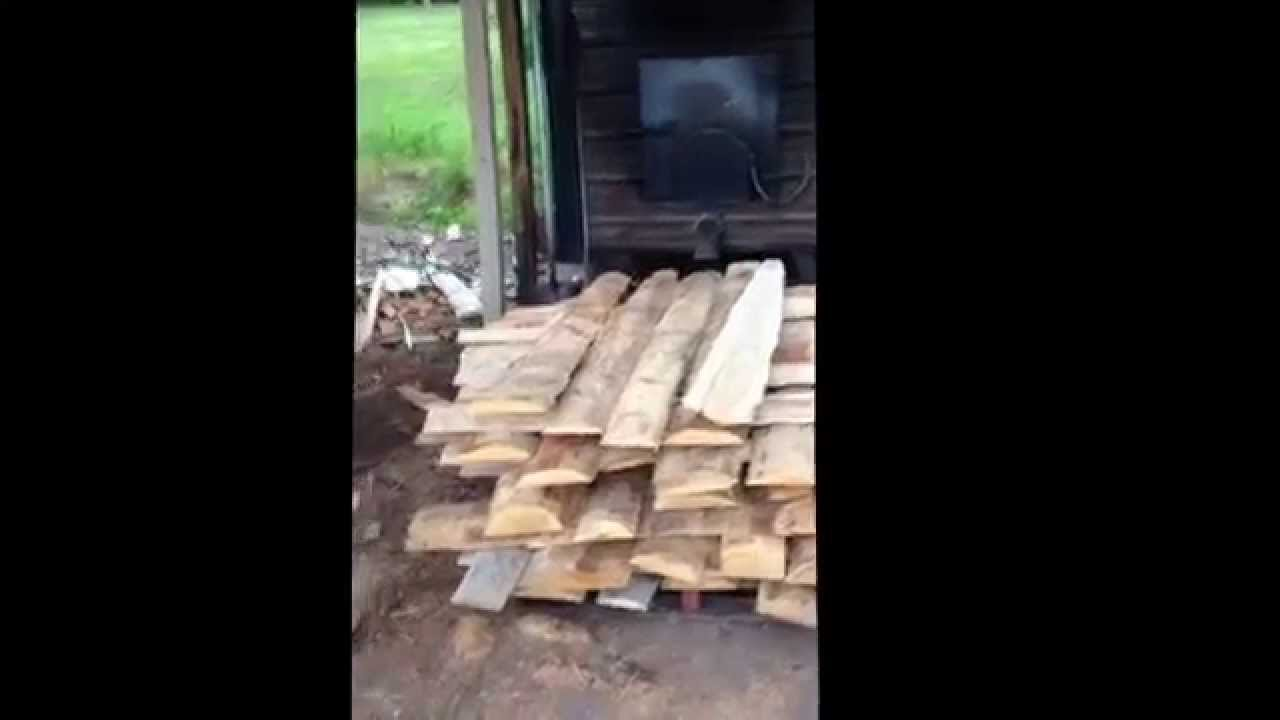 Wood fired furnace heats lumber drying kilns. - YouTube