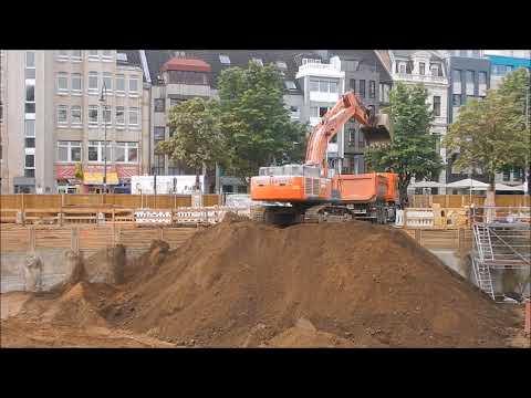 Köln Hitachi 470 lädt LKW