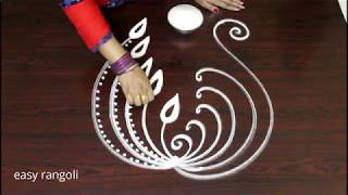 Creative Peacock Rangoli art designs - Latest kolam - Muggulu without dots