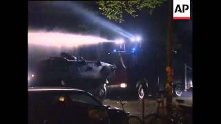 Protestors throw stones at police and water cannons fired