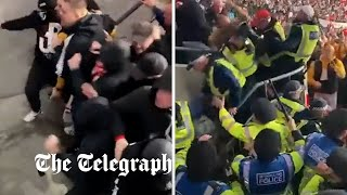 Hungarian fans clash with police during England game at Wembley