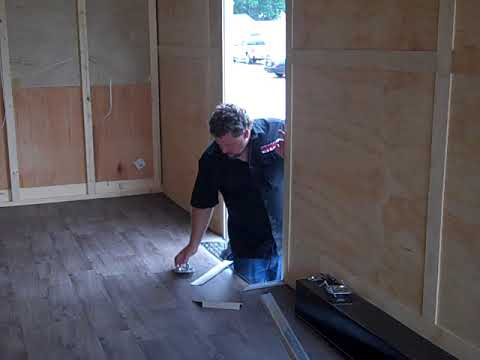 installing flooring in enclosed trailer from midwestracecabinets.com