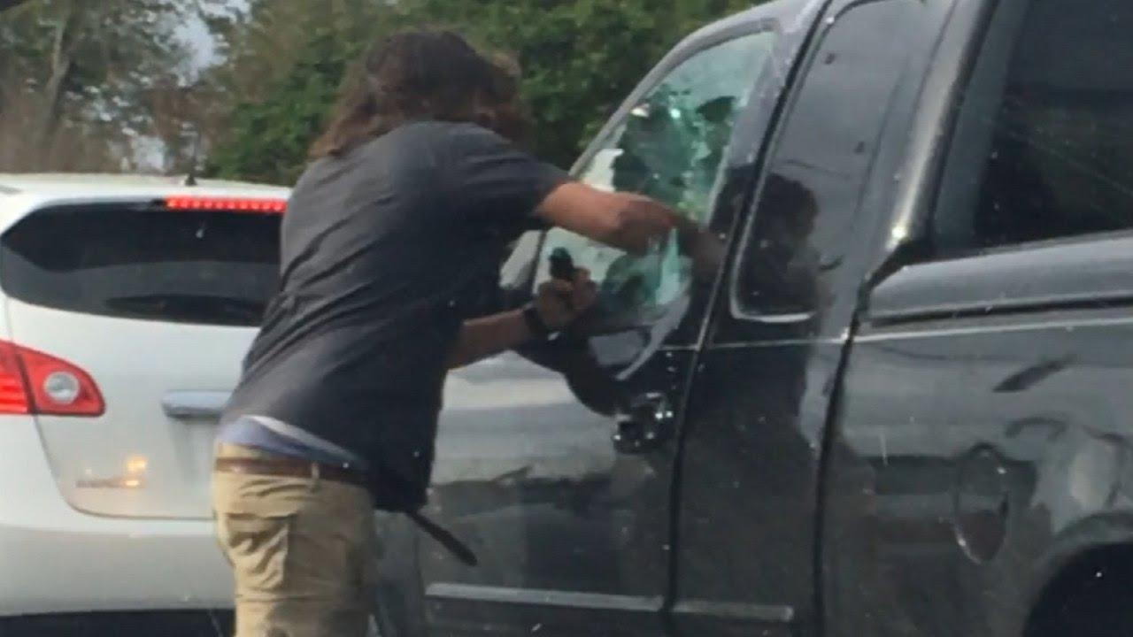 Watch Man Punch Fist Through Truck Window And Pepper Spray