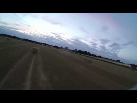 Falcon Evo FPV Flying Wing low flying with straw bales!