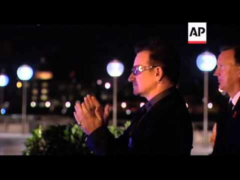 PM and Bono watch harbour area turn red for World Aids Day
