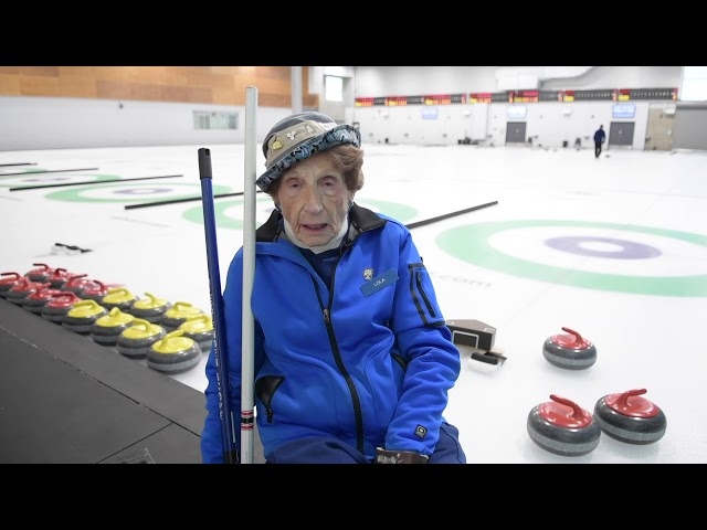 Lola Holmes, who turned 100 last week, explains how using a 'delivery stick' has allowed her to keep playing the game, even with Carpal Tunnel syndrome.
