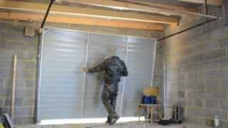 видео Откидные ворота для гаража своими руками