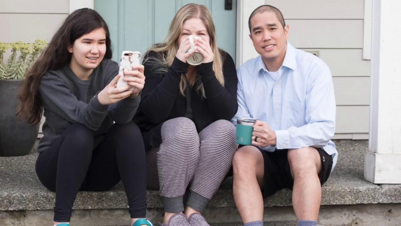 Woman has fun during coronavirus pandemic with family porch photos