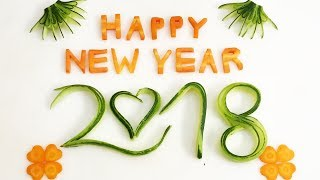 Happy New Year 2018 with cucumber and carrot carving design