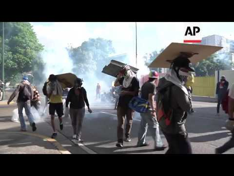 Thousands march in Caracas as protests continue