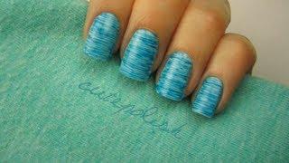 One of cutepolish's most viewed videos: Striped Nail Art using FLOSS?!