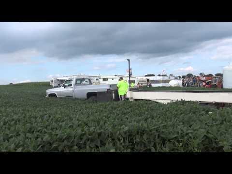 Pulling truck flies into bean field(outside view)