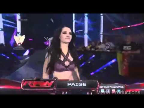 Paige enters the arena with CM Punk's theme song and AJ Lee gets angry‎