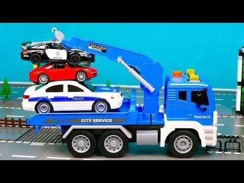 Полицейский эвакуатор перевозит полицейскую машину в автосервис 387 Серия Мир Машинок