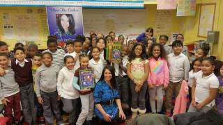 Author, Christine DerOhannesian donates Santa's Magical Chimney to PS214, Bronx 12/22/16