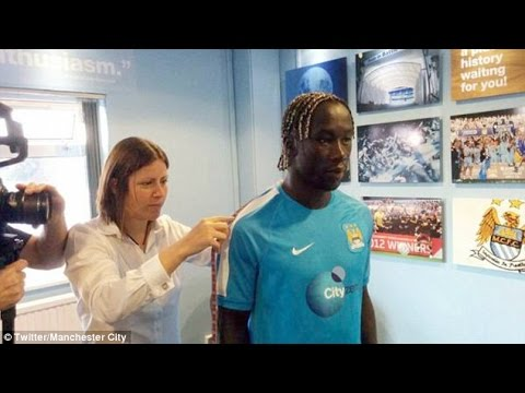 Bacary Sagna joins new Manchester City team-mates and gets fitted out with new club suit