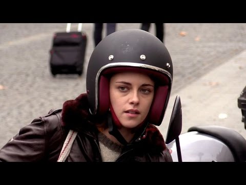 EXCLUSIVE: Kristen Stewart driving a scooter outside Gare du Nord in Paris
