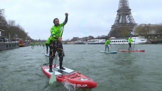 Hundreds of paddle boarders take part in Paris race | AFP