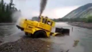 A Russian tractor driver refuses to give up after his vehicle gets stuck in a river. thumbnail
