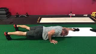 EricCressey.com: Slideboard Bodysaw Push-up w/Opposite Leg Reach