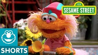 Sesame Street: Elmo Helps Zoe Ride a Scooter
