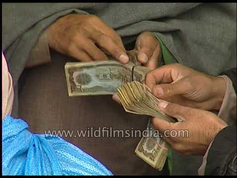 Afghan Men Exchange Money At An Open Market For Currency Exchange