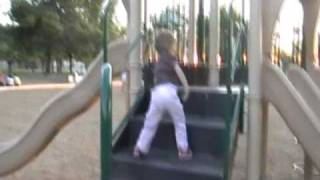 Arthrogryposis child  3 years old  -  Arielle sliding at the park