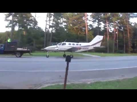 A Plane Is Given A Police Escort Down GA HWY 247 To Macon