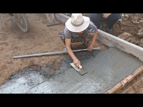 Good job! Rural construction workers render the ground of the courtyard with sand & House renovation
