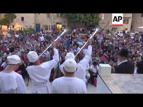 Passover faithful re-enact sacrifice of lamb