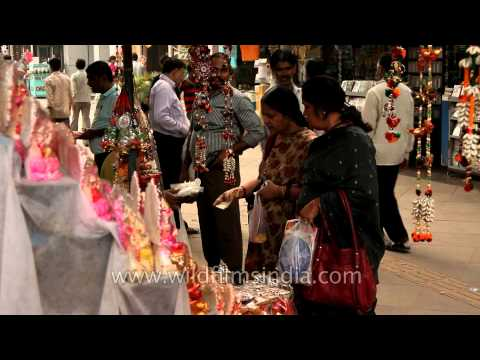 People buying idols of deities at a roadside stall in New Delhi on the eve of Diwali