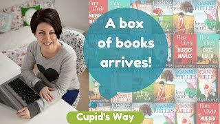Opening the box of Cupid's Way paperbacks