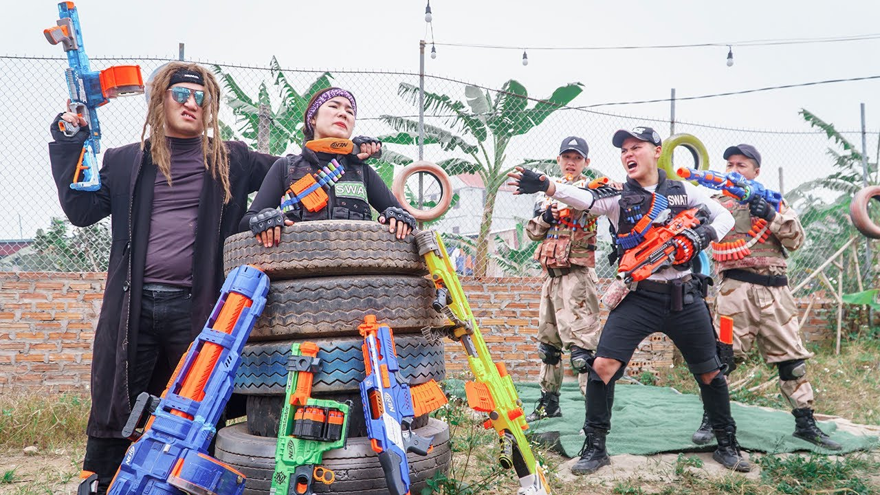 LTT Game Nerf War : Warriors SEAL X Nerf Guns Fight Rocket Crazy Murder Female Police Officer