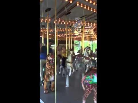 Bodhi riding the Carousel