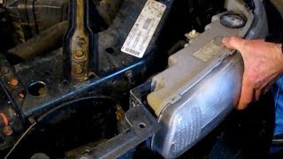 Repairing front end crash damage on a 2001 Buick Century: Part 2: Replacing headlights and hood
